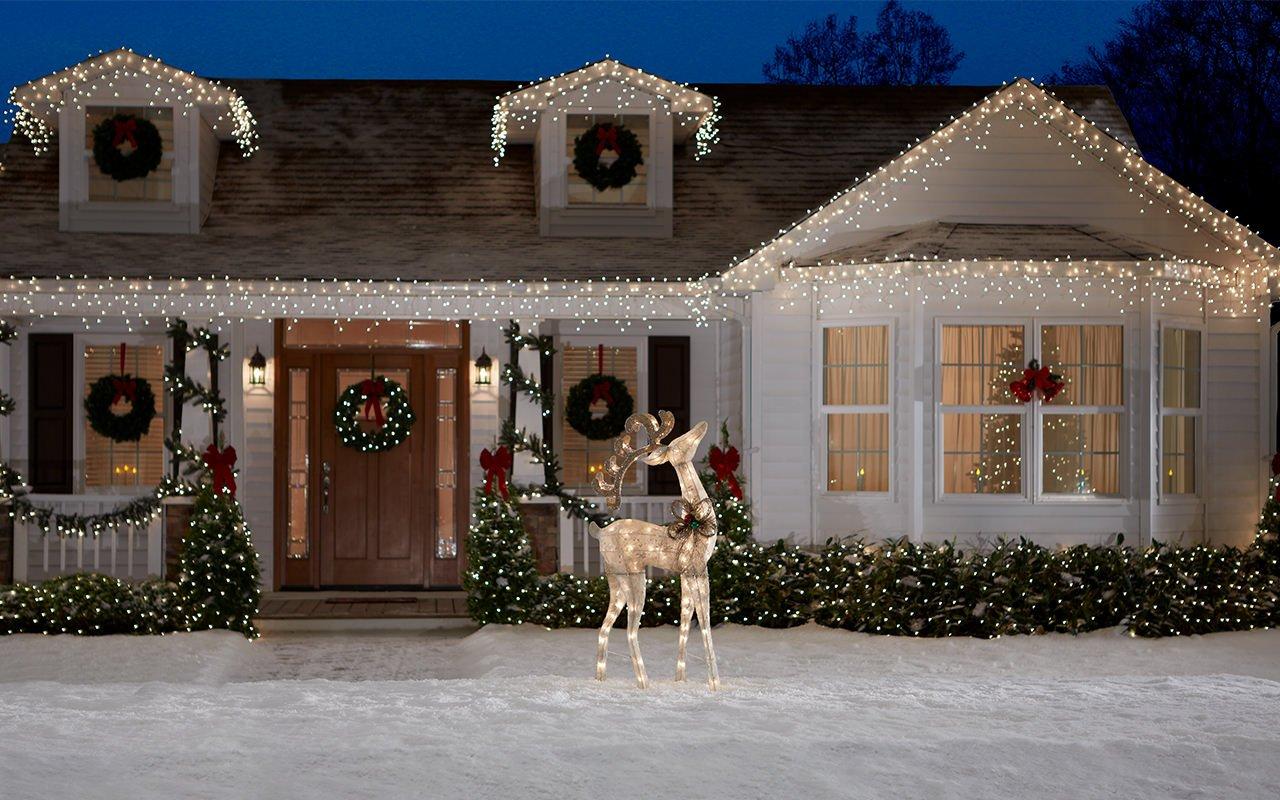 house-facade-in-studio-snow-deer-lights