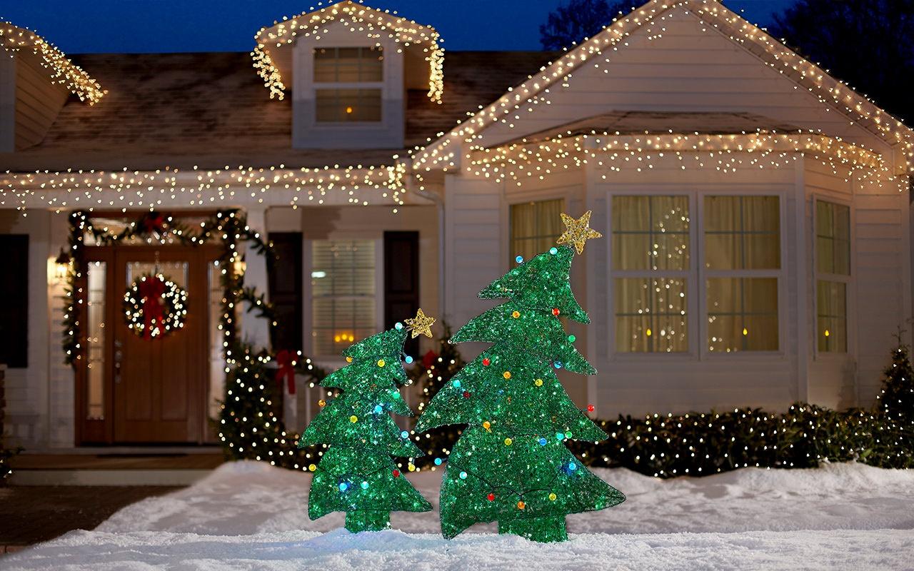 house-facade-in-studio-snow-christmas-trees